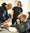 Christing Mehr (center) gives some advice to a couple of students building their egg-drop apparatus.