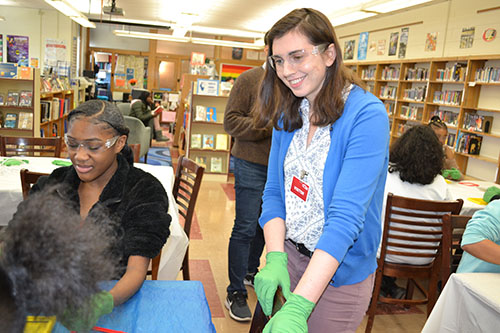 Physics' Secondary Education Partnership Coordinator, Maggie Mahmood interacts with a Franklin STEAM Studio student.
