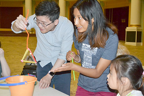 MechSE Assistant Professor Jie Feng and Adriana Coariti demonstrate the bubble activity for youngsters at the Orpheum.