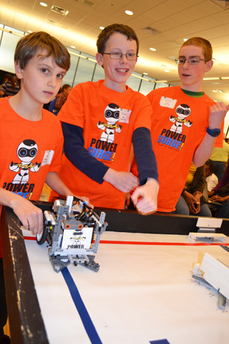 Members of the PowerSurge robotics team prepare to compete.