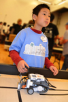 Youngster prepares to compete in the 4-H Robotics Competition.