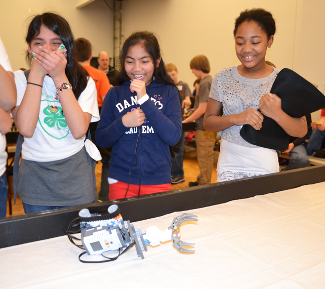 Members of a robotics team enjoy the competion