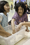 two girls play with oobleck