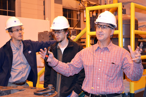 Instructor Jeff Roessler (left) a CEE 398 student, and Abbott Power Plant Engineer during a site visit to the power plant