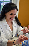 SACNAS member Elena Montoto, a PhD Student in Chemistry and a local student