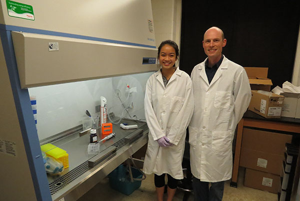 Bioengineering junior Joy Chen, with her mentor, cancer researcher Dr. Erik Nelson.