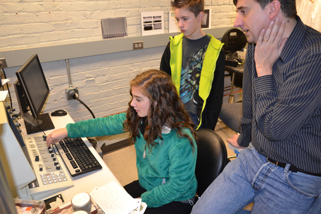 Joe Muskin (right) works with two Danville Luteran students on the SEM.
