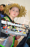 FLL contestant from Da Ex Bots holds some of his team's Lego equipment.