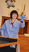 "Tina Huang exhibits a flask she ""turned silver"" by shaking the contents together."