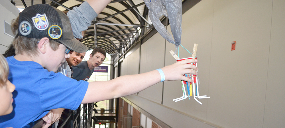 During Illinois Space Day 2019, a Mahomet Seymour 7th grader prepares to test his team's egg drop lander
