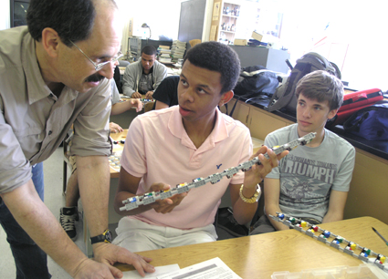 Science teacher David Stone discusses procedures for using the Lego kits with students during the evaluation session