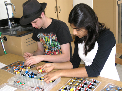 Two Uni High students work with Lego kit on DNA/RNA in order to determine its usefulness as a hands-on learning tool.