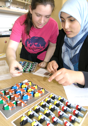 Two Uni High students working on DNA/RNA Lego kit.