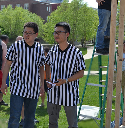 The two officials who referreed the competition look on as a team nears the end of their 5-minute practice session.