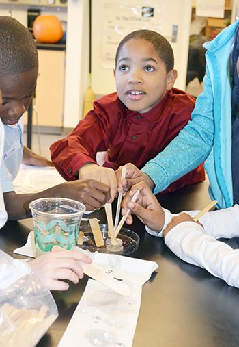 A BTW 3rd grader participates in one of NanoSTRuCT's hands-on activities about biotechnology.