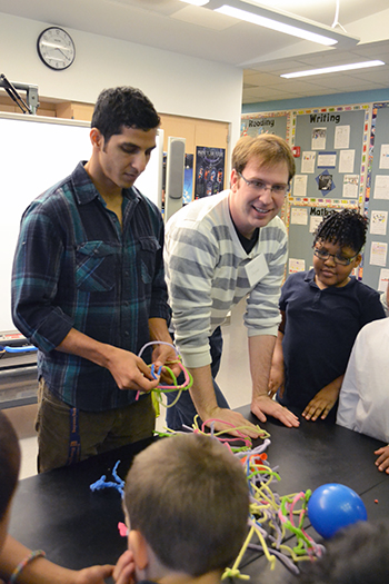 Alex Cerjanic, NanoSTRuCT co-founder and leader, interacts with students during one of their sessions.