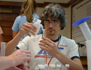 EnLiST teacher does a hands-on project during chemistry professional development.