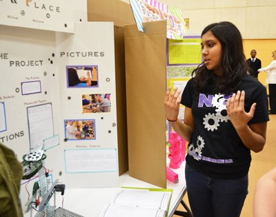 Next Gen middle school student discusses her robotics project, entitled