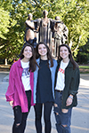 The Ponicki triplets in front of the Alma Mater.