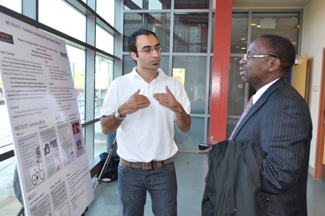 Sameh Tawfick explains the particulars of ME 370 and 371 to Illinois Provost Ilesanmi Adesida.