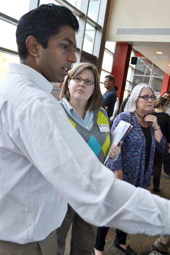 Clockwise from left: CEE grad student Jeevaka Somaratna explains CEE 398 to I-STEM evaluator Ann Horton-Weis.