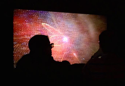 Visitors to NCSA's Advanced Visualization Lab watch visualizations of scientific phenomena on earth and in space