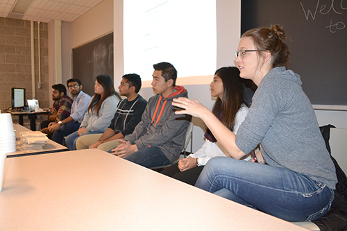 Several Illinois students share during the student panel session.