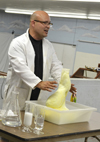 Jesse Miller performs a demonstration with hydrogen peroxide and soap.