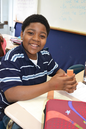 Middle school student works on his engineering design project.