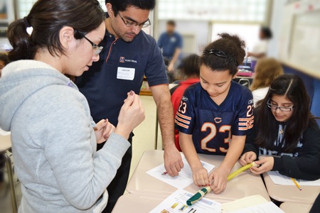 iRISE grad students work with Edison middle schoolers on their design project.