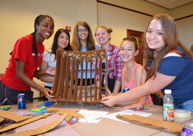 Group of campers from a joint session of GLAM and G-BAM show off the solar collector they were working on.