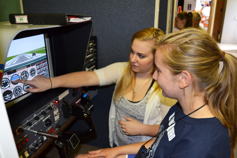 Flightstar instructor (left) shows a GAMES camper how to navigate while using the flight simulator.