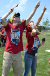 Brian Woodard and a couple of GAMES campers follow the flight of a rocket during the launch event at Dodds' Park.