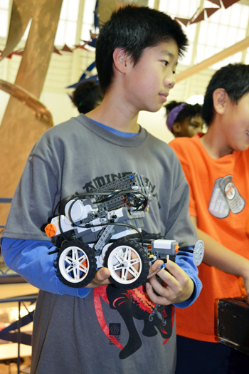 Competitor waits his turn during the recent practice competition held by iRobotics.