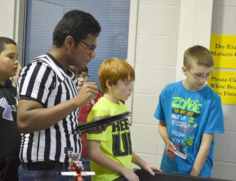 iRobotics member judges an event during the practice tournament the organization held in November.