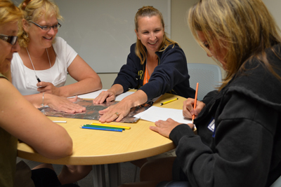 Teachers enjoying hands-on activity during iRISE 2012 summer workshop.