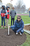 Professor Mattia Gazzola (front center) with the fledgling Swamp White Oak he helped to plant.