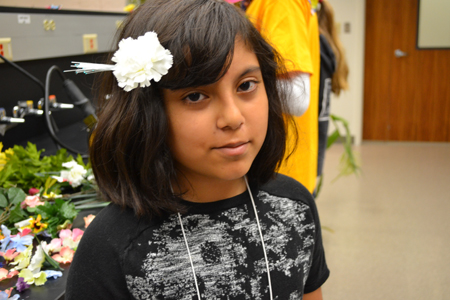 Camper wears the flower she made for her hair.
