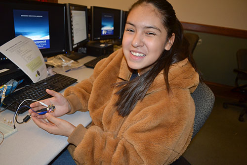 Whitney eighth grader Quiriat Ortiz shows off the circuit she made then programmed.