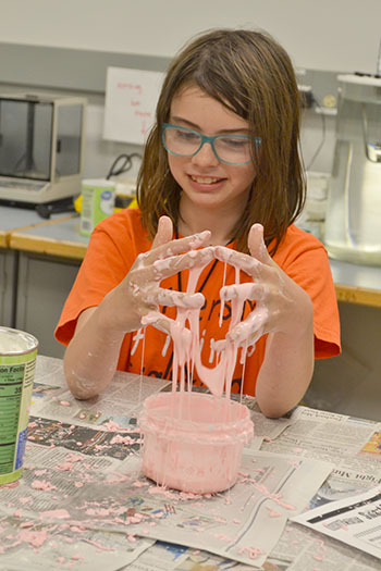 A  Mid-GLAM camper plays with some Oobleck she made during one of the hands-on activities.