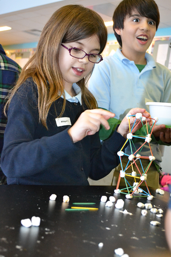 Students build a tower taller prior to giving it the Jello earthquake shake test.