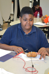 "A BTW student makes a ""potato battery"" during the Brady STEM Academy after-school program."