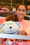 A Chic Tech participant gets cozy with her stuffed animal during Girls' Night.