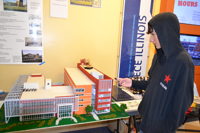 A young visitor to EOH 2014 plays with the lights in a model of the new ECE building.