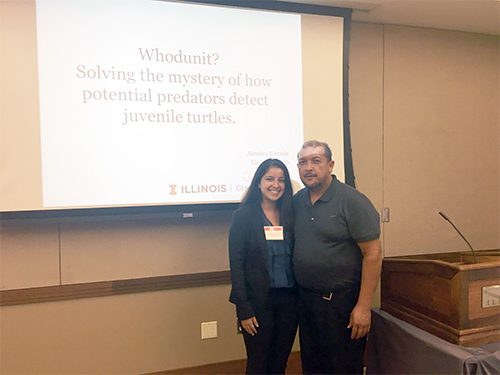 Alondra Estrana (left) with her father at her presentation for her research.