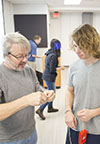 Mats Selen (left) works with a Physics 211 student on an iOLab activity.