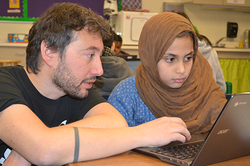 Mattia Gazzola (left) helps a King student create a keychain using TinkerCAD.
