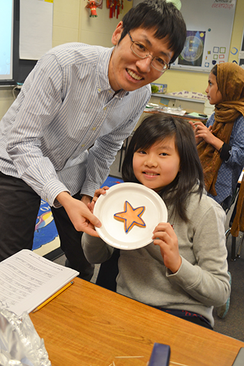 Assistant Professor Chenhui Shao (left), with the student who guessed the shape of her cookie with the fewest toothpicks.