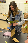 A Monticello Middle School student assembles her team's incubator.