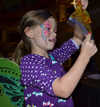 Local youngster appreciates slime she just made in an experiment during a recent REACT outreach event at the Orpheum Children's Science Museum